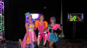 From left to right: Katy Perry, Nicki Minaj, Rihanna dance-doubles in colorful costumes at the Just Dance 4 dance floor in the Nintendo Gaming Lounge at San Diego Comic-Con 2012